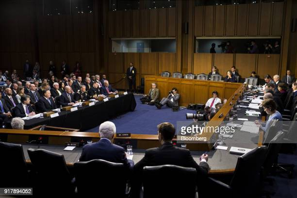 Dan Coats director of national intelligence left center testifies during a Senate Intelligence Committee hearing on worldwide threats in Washington...