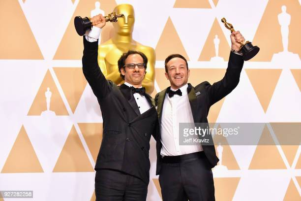 "Dan Cogan and Bryan Fogel winners of the Best Ducumentary Feature for ""Icarus"" pose in the press room during the 90th Annual Academy Awards at..."