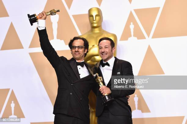 Dan Cogen and Bryan Fogel pose in the press room for Best Documentary Feature Icarus during the 90th Annual Academy Awards at Hollywood Highland...
