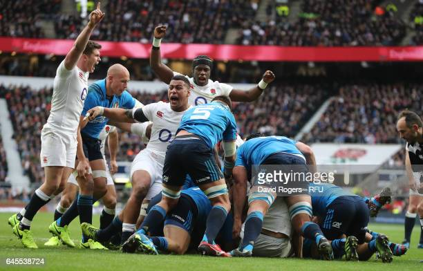 Dan Cole of England burrows over to score the opening try during the RBS Six Nations match between England and Italy at Twickenham Stadium on...