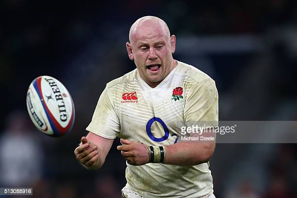 Dan Cole of England passes the ball during the RBS Six Nations match between England and Ireland at Twickenham Stadium on February 27 2016 in London...