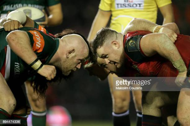 Dan Cole of Leicester Tigers scrumsdown with Stephen Archer of Munster during the European Rugby Champions Cup match between Leicester Tigers and...