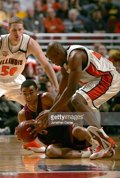 Dan Coleman of the Minnesota Golden Gophers looks to pass from the floor against Roger Powell Jr #43 of the Illinois Fighting Illini during the...