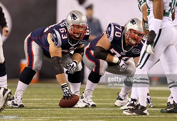 Dan Connolly and Logan Mankins of the New England Patriots in action against the New York Jets on November 13, 2011 at MetLife Stadium in East...