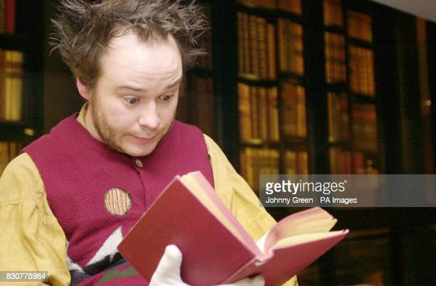 Dan Copeland dressed as Bilbo Baggins whom he is currently playing in The Hobbit at the Queen's Theatre in London reads through a first edition of...