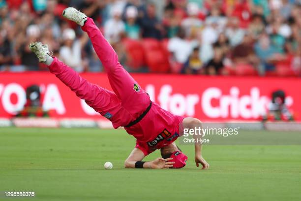 Dan Cristian of the Sixers drops a catch during the Big Bash League match between the Sydney Sixers and the Brisbane Heat at Metricon Stadium, on...
