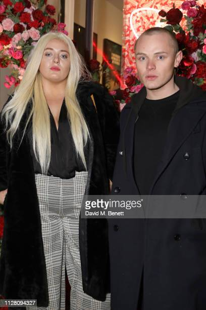 Dan Crossley and guest attend the VIP private view of the 'Love And Other Crimes' exhibition at Maddox Gallery on February 07 2019 in London England