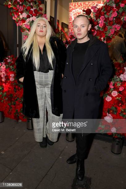Dan Crossley and guest attends the VIP private view of the 'Love And Other Crimes' exhibition at Maddox Gallery on February 07 2019 in London England