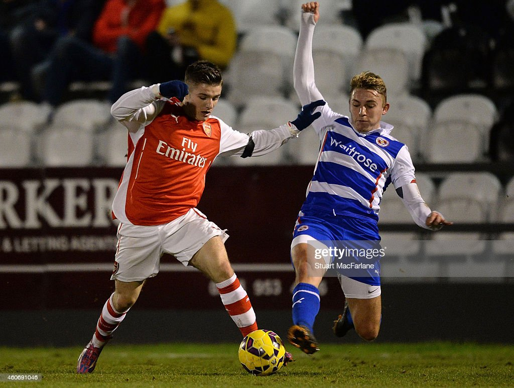 Dan Crowley of Arsenal is challenged by Jake Sheppard of Reading during the FA Youth Cup 3rd Round match between Arsenal and Reading at Meadow Park on December 19, 2014 in Borehamwood, England.