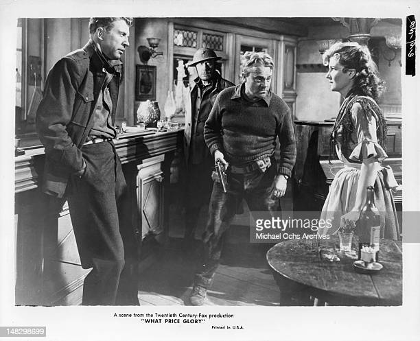 Dan Dailey and James Cagney looking at Corinne Calvet in a scene from the film 'What Price Glory' 1952