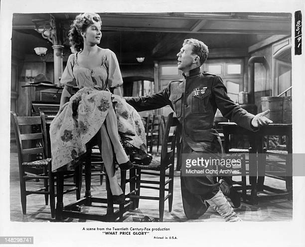 Dan Dailey getting down on his knee in front of Corinne Calvet in a scene from the film 'What Price Glory' 1952