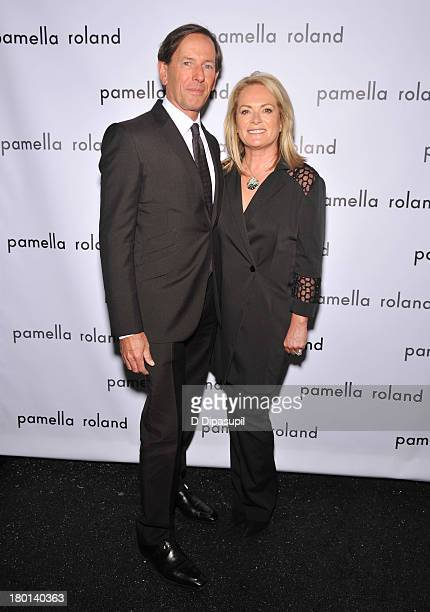 Dan De Vos and Pamella Roland pose backstage at the pamella roland Spring 2014 fashion show during MercedesBenz Fashion Week on September 9 2013 in...
