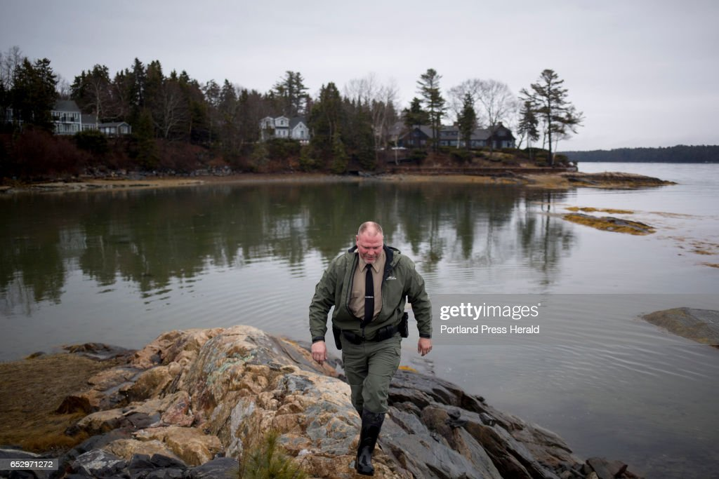 Dan Devereaux walks along the rocks at Mere Point Boat Launch. Devereaux is the Marine Resource Officer and Harbor Master for the town of Brunswick.