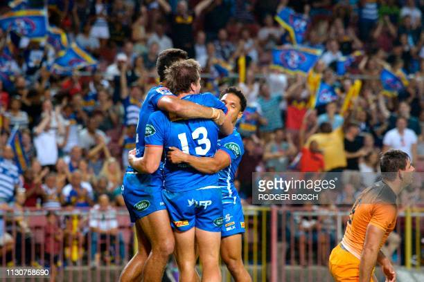 Dan du Plessis celebrates with teammates after scoring a try during the Super Rugby rugby union match between South Africa's Stormers and Argentina's...