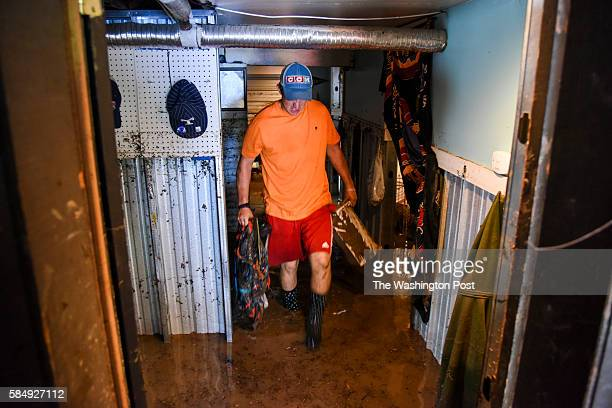 Dan Durantaye clears his flooded basement after heavy floods devastated the historic district of the town on Sunday July 31 in Ellicott City MD...