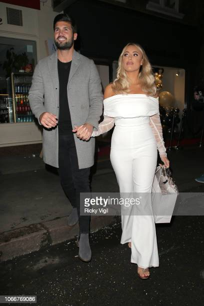 Dan Edgar and Amber Turner seen attending A by Andre launch party at Noho Studios on November 12 2018 in London England