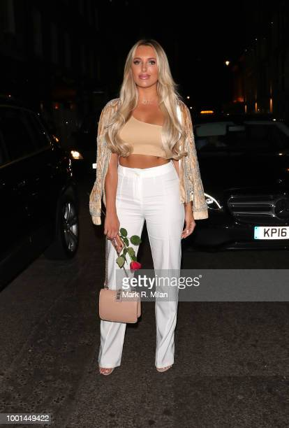 Dan Edgar buys Amber Turner a rose as they leave MNKY House on July 18, 2018 in London, England.