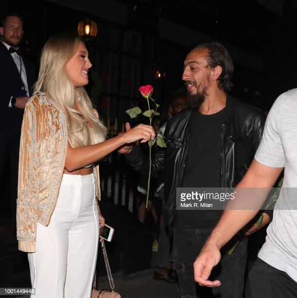 Dan Edgar buys Amber Turner a rose as they leave MNKY House on July 18 2018 in London England