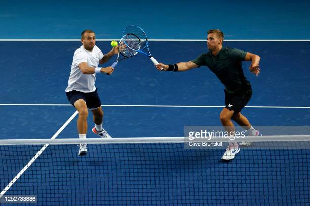 Dan Evans and Lloyd Glasspool both go for the same ball during their doubles semi final match against Kyle Edmund and James Ward on day 4 of...