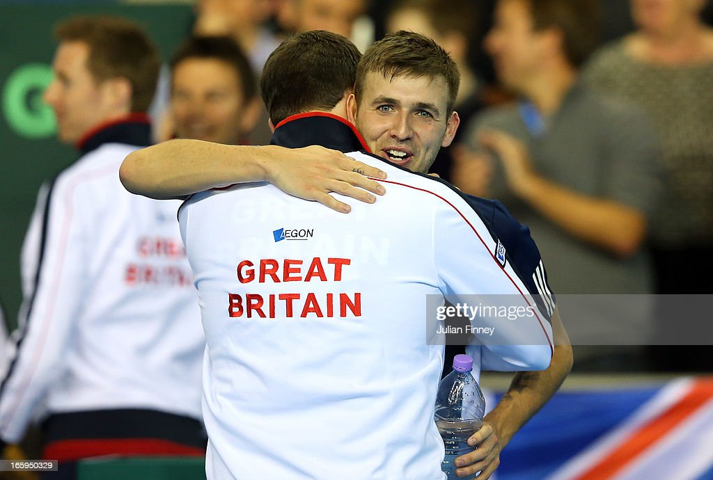 Dan Evans celebrates after his straight sets victory over Evgeny Donskoy of Russia during day three of the Davis Cup match between Great Britain and Russia at the Ricoh Arena on April 7, 2013 in Coventry, England.
