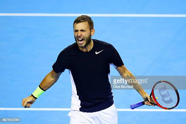 Dan Evans of Great Britain celebrates a point during his singles match against Leonardo Mayer of Argentina during day three of the Davis Cup semi...