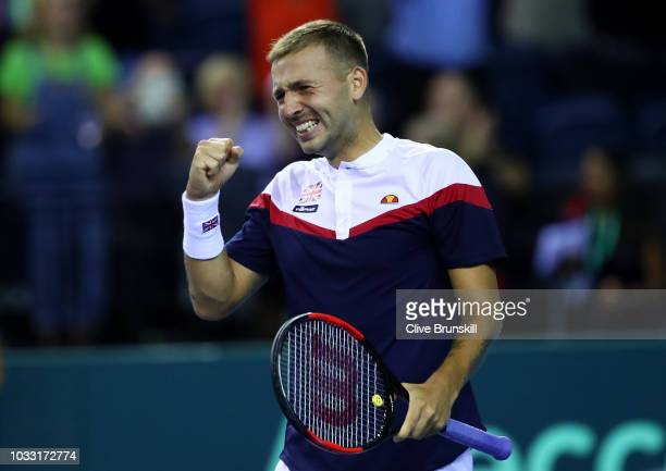 Dan Evans of Great Britain celebrates after match point in his match against Denis Istomin of Uzbekistan during day one of the Davis Cup by BNP...