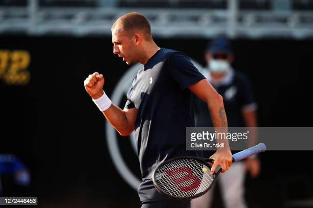 Dan Evans of Great Britain celebrates after winning the second set in his round one match against Hubert Hurkacz of Poland during day one of the...