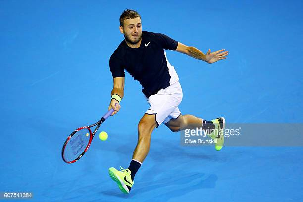 Dan Evans of Great Britain hits a forehand during his singles match against Leonardo Mayer of Argentina during day three of the Davis Cup semi final...