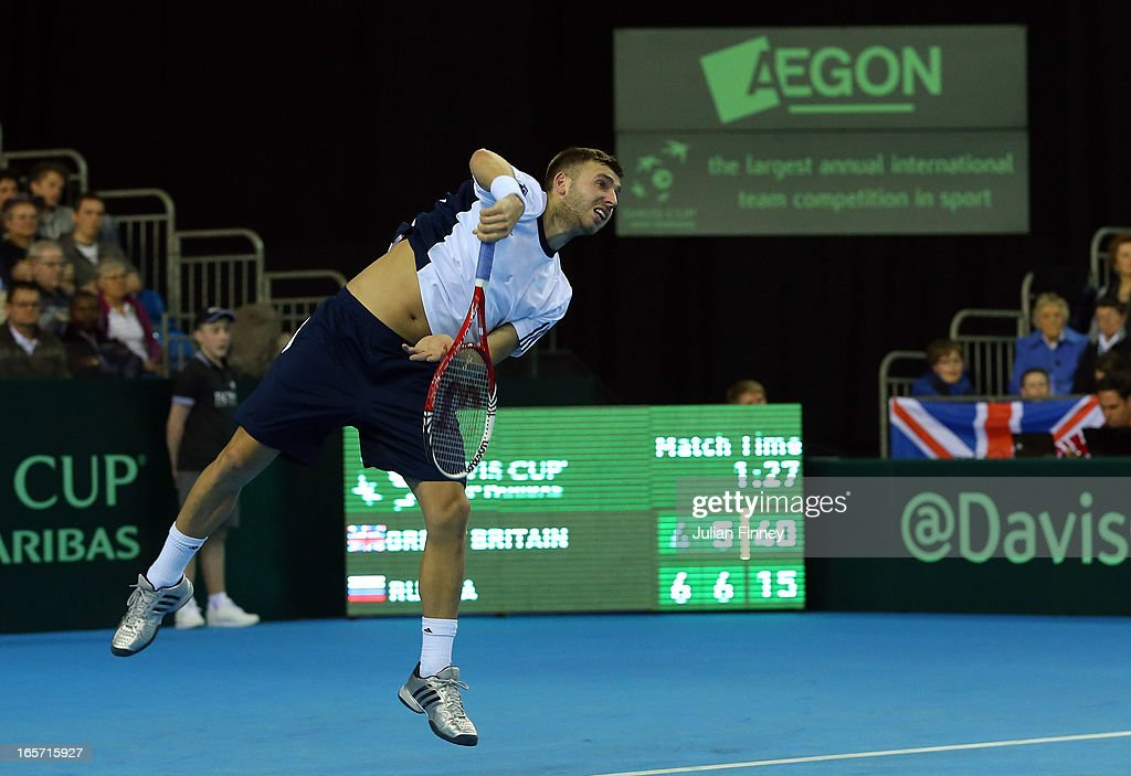 Dan Evans of Great Britain in action in his match against Dimitri Tursunov of Russia during day one of the Davis Cup match between Great Britain and Russia at the Ricoh Arena on April 5, 2013 in Coventry, England.