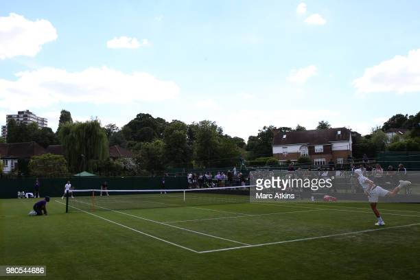 Dan Evans of Great Britain in action with Evan Hoyt of Wales during Wimbledon 2018 PreQualifying at Southlands College Tennis Courts on June 21 2018...