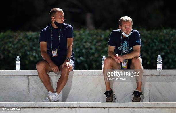 Dan Evans of Great Britain looks on alongside Coach Mark Hilton as they watch Kyle Edmund of Great Britain in his round one match against Marco...