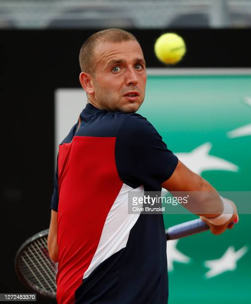 Dan Evans of Great Britain looks to play a backhand in his round one match against Hubert Hurkacz of Poland during day one of the Internazionali BNL...