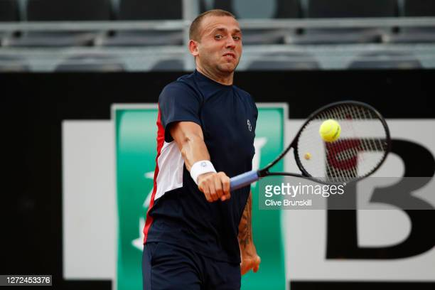 Dan Evans of Great Britain plays a backhand in his round one match against Hubert Hurkacz of Poland during day one of the Internazionali BNL D'Italia...