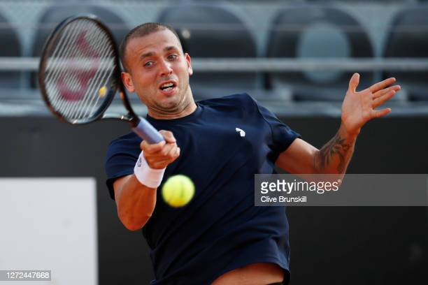 Dan Evans of Great Britain plays a forehand in his round one match against Hubert Hurkacz of Poland during day one of the Internazionali BNL D'Italia...