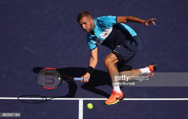 Dan Evans of Great Britain plays a forehand volley against Kei Nishikori of Japan in their second round match during day seven of the BNP Paribas...