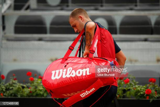 Dan Evans of Great Britain reacts as he leaves the court after loosing his round one match against Hubert Hurkacz of Poland during day one of the...