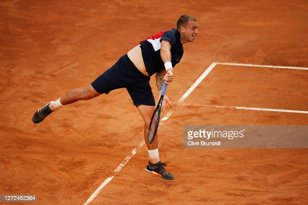 Dan Evans of Great Britain serves in his round one match against Hubert Hurkacz of Poland during day one of the Internazionali BNL D'Italia at Foro...