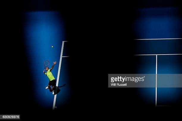Dan Evans of Great Britain serves to Richard Gasket of France in the Mens singles match on day four of the 2017 Hopman Cup at Perth Arena on January...
