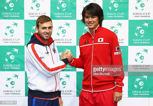 Dan Evans of Great Britain shakes hands with singles match opponent Taro Daniel of Japan ahead of the Davis Cup World Group 1st round tie between...