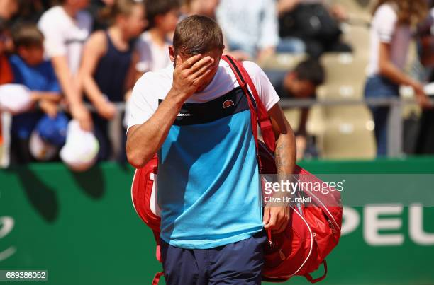 Dan Evans of Great Britain shows his dejection as he walks off court after his straight sets defeat by Kyle Edmund of Great Britain in their first...