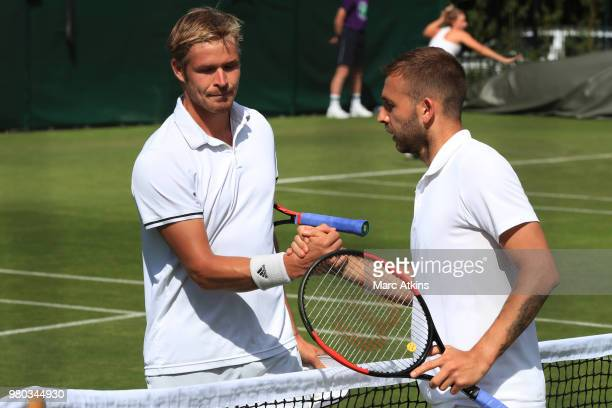 Dan Evans of Great Britain skies hands with Evan Hoyt of Wales after his victory during Wimbledon 2018 PreQualifying at Southlands College Tennis...
