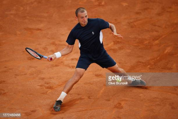 Dan Evans of Great Britain stretches to play a forehand in his round one match against Hubert Hurkacz of Poland during day one of the Internazionali...