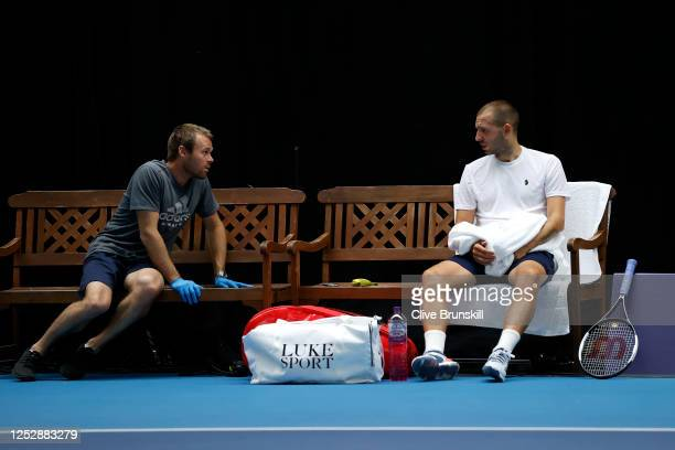 Dan Evans talks to his Coach, Mark Hilton at the change of ends during his singles semi final match against Andy Murray on day 5 of Schroders Battle...