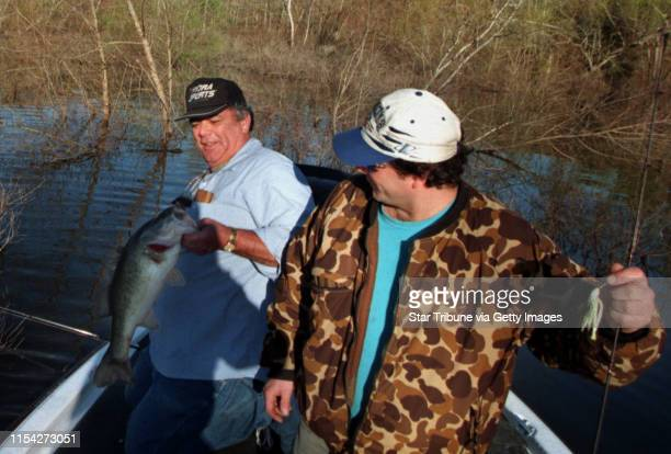Dan Fayo left of Brooklyn Center fights a 61oz bass as his son Phillip helps him land the fish at Lake Sam Rayburn near Lufkin Texas Dan was flipping...