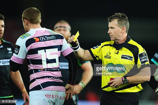 Dan Fish of Cardiff Blues is shown a yellow card by Match Referee Nigel Owens during the Guiness Pro12 match between the Ospreys and Cardiff Blues at...