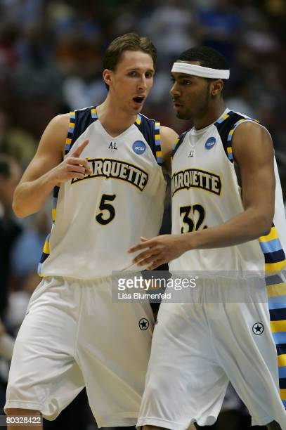 Dan Fitzgerald and Lazar Hayward of the Marquette Golden Eagles talk during the South Region first round of NCAA Basketball Tournament against the...