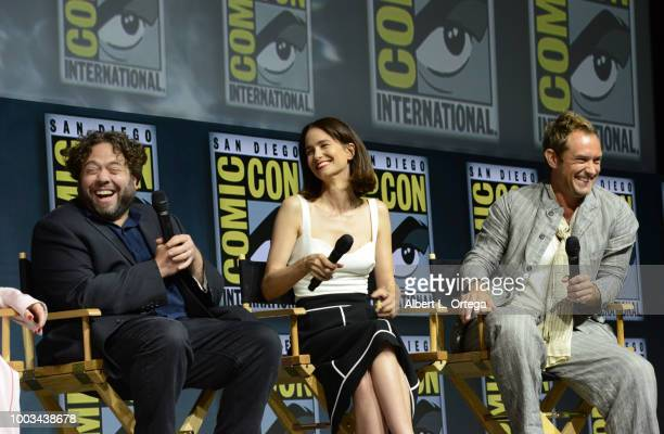 Dan Fogler Katherine Waterston and Jude Law speak onstage at the Warner Bros 'Fantastic Beasts The Crimes of Grindelwald' theatrical panel during...
