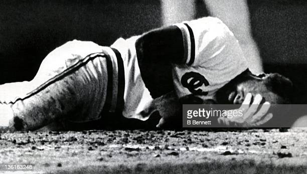 Dan Ford of the Baltimore Orioles grimaces in pain after being beaned in the 5th inning of Game 2 in the 1983 World Series against the Philadelphia...