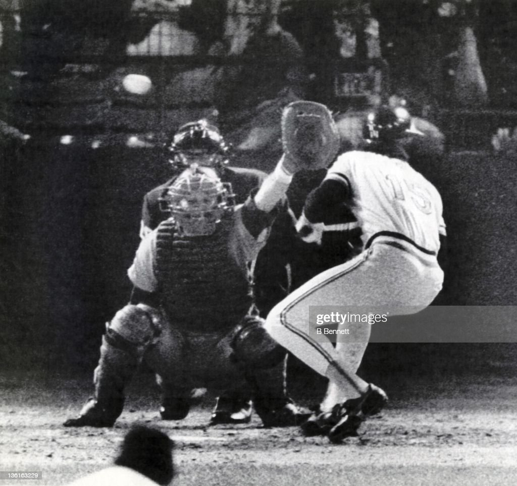 Dan Ford #15 of the Baltimore Orioles is beaned in the fifth inning of Game 2 in the 1983 World Series against the Philadelphia Philles on October 12, 1983 at Memorial Stadium in Baltimore, Maryland. The Orioles defeated the Phillies 4-1.