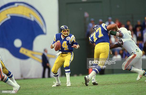 Dan Fouts of the San Diego Chargers circa 1987 dropd back to pass against the Miami Dolphins at Jack Murphy Stadium in San Diego California